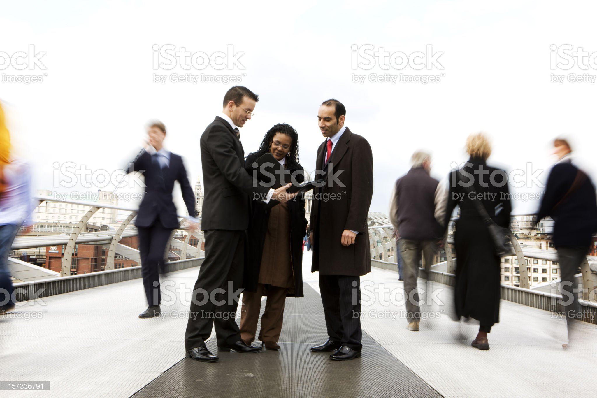 Public meeting between a small diverse group of business professionals royalty-free stock photo