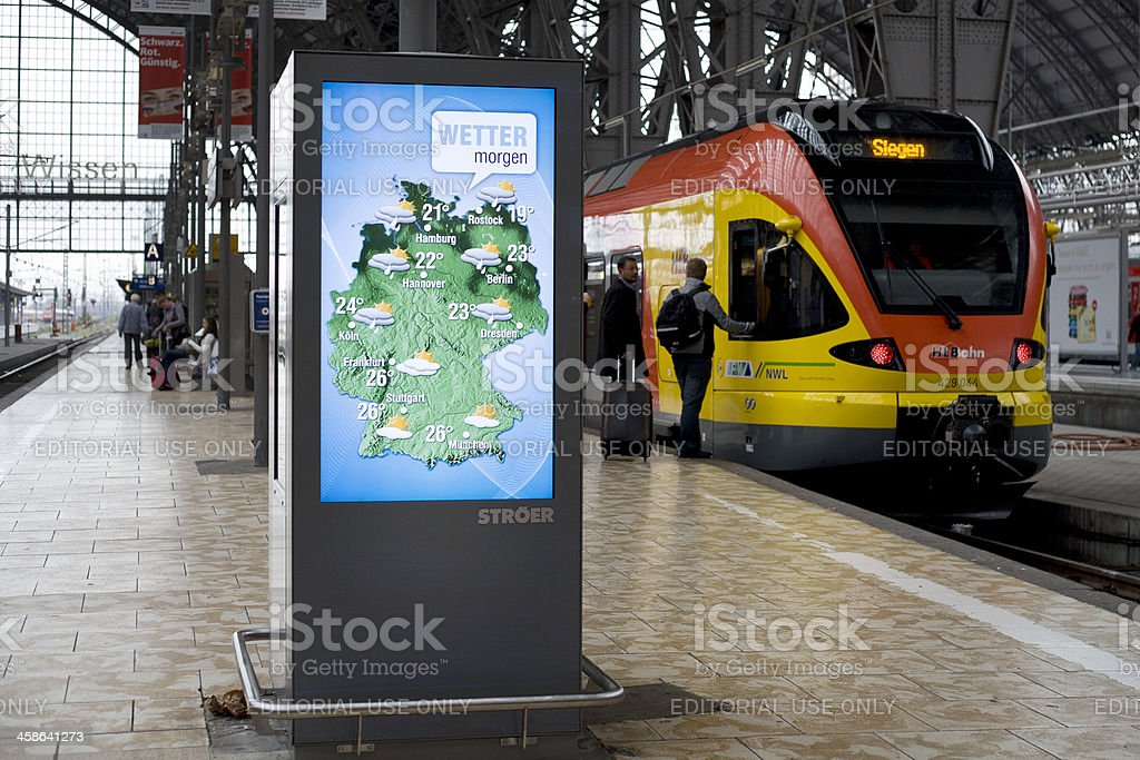 Public news screen at the station, weather forecast royalty-free stock photo