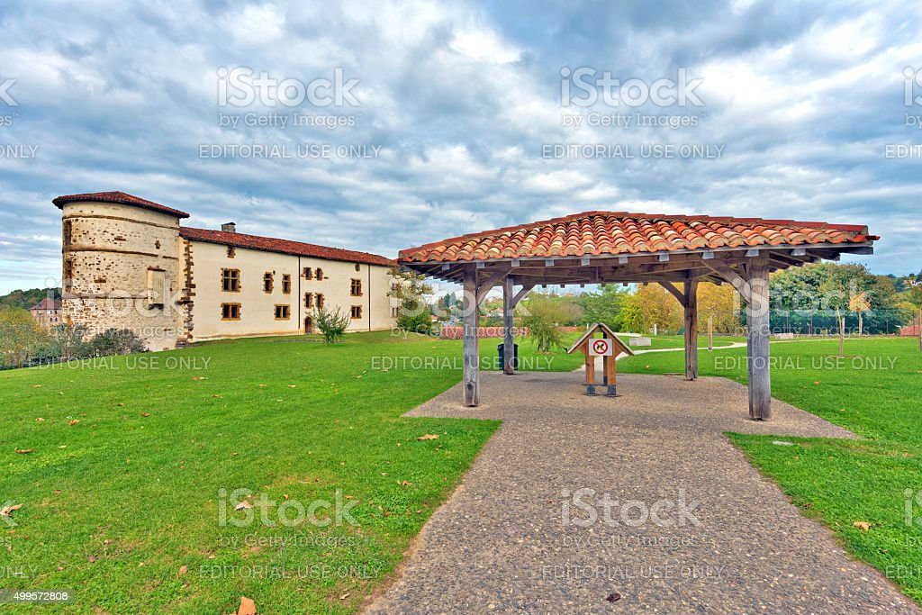 Public Park and Ezpeleta Barons castle in Basque Espelette village stock photo