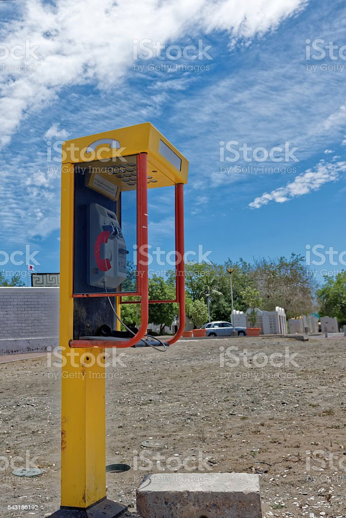 Public payphone with the receiver off the hook stock photo
