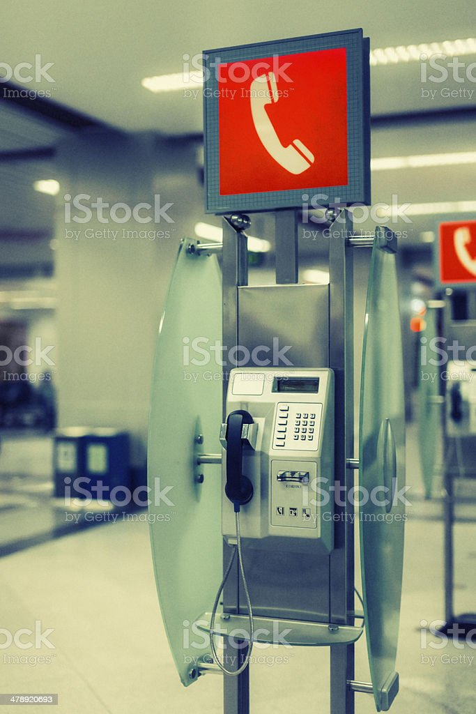 Public phone in airport hall royalty-free stock photo