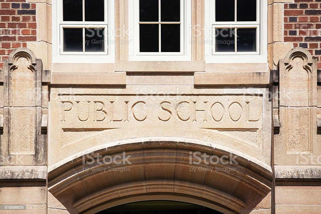 Public School Sign Carved in Granite above Entrance stock photo