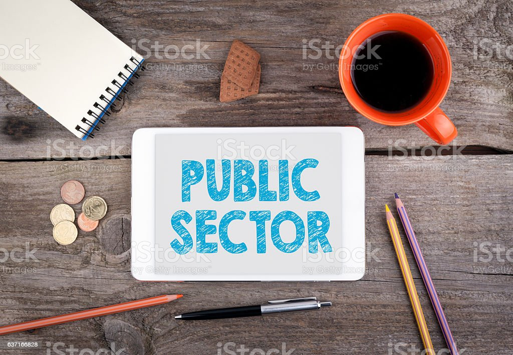 Public Sector. Text on tablet device on a wooden table stock photo