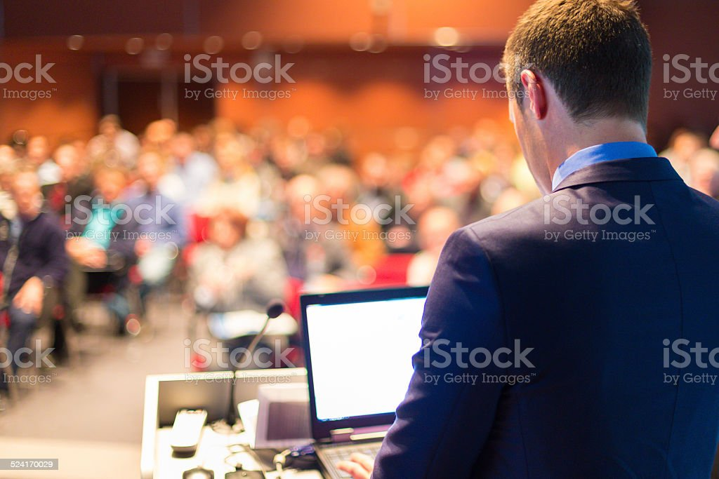 Public speaker at Business Conference. stock photo