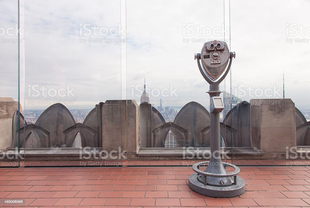 public telescope pointed on Manhattan buildings stock photo