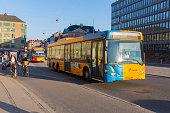 A Public Transport Bus Passes Cyclists in Copenhagen