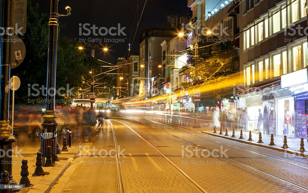 Public transport metropolis, traffic and lights of tram at night. stock photo