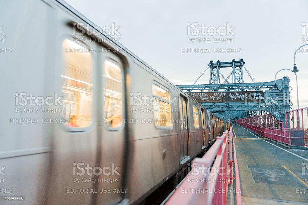 NYC Public Transportation Subway Train Crosses Williamsburg Bridge Into Manhattan stock photo