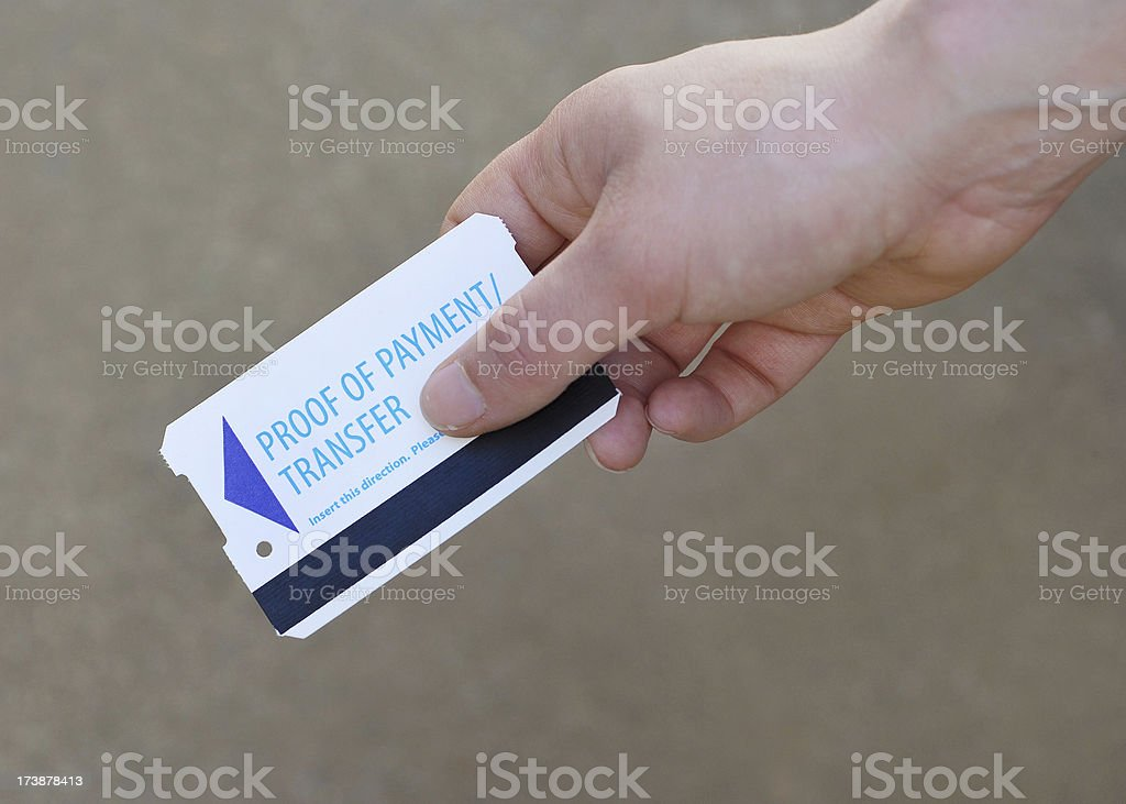 A woman\'s hand hold a public transportation transfer card.