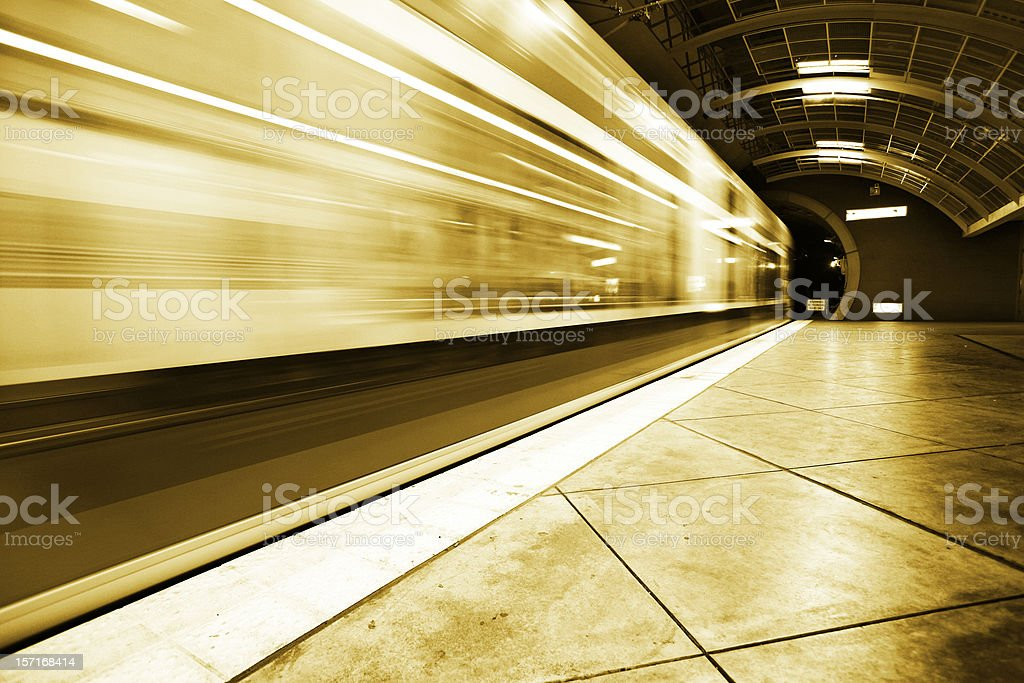 Public Transportation Train Speeding Away royalty-free stock photo