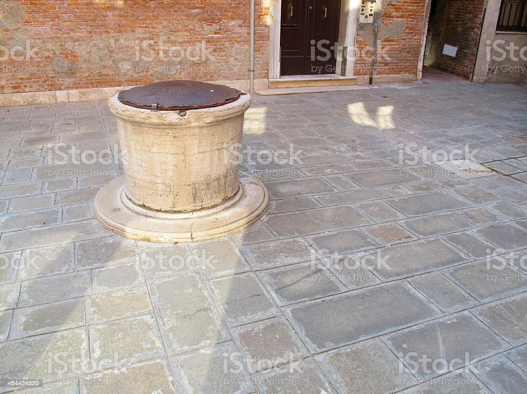 Public Well in a Venetian Courtyard, Italy stock photo