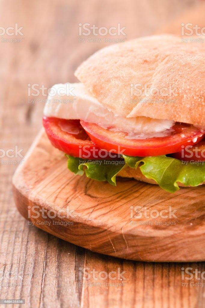 Puccia bread with mozzarella and tomato. stock photo