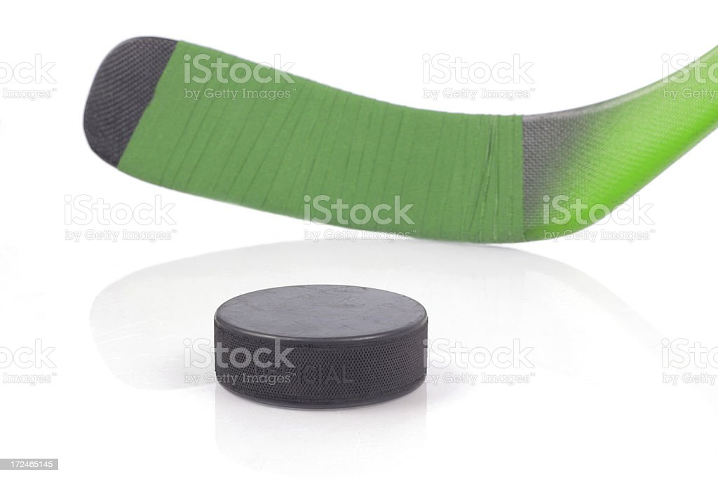puck and hockey stick on ice royalty-free stock photo
