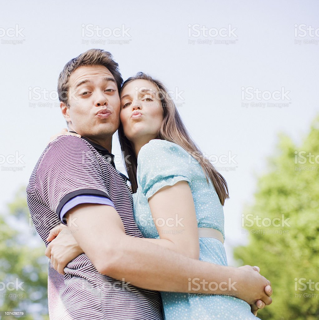 Puckering couple hugging outdoors royalty-free stock photo