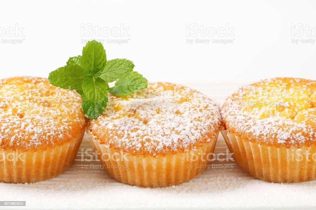 Pudding filled lemon cupcakes stock photo