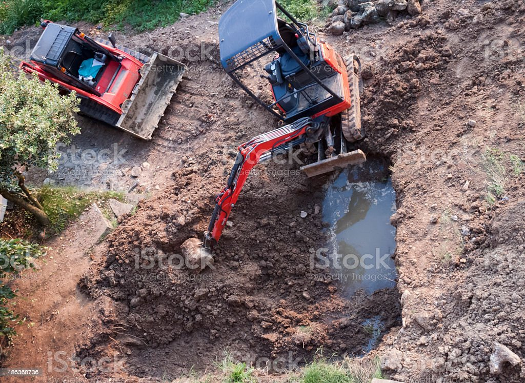 Puddle And Excavators stock photo