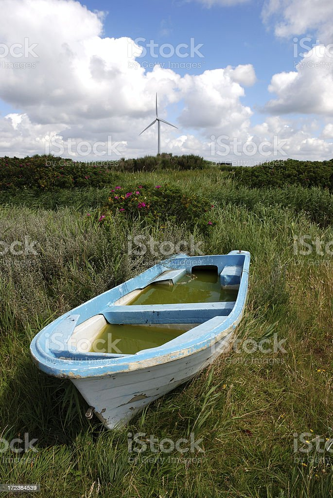 puddle in the rowboat and windturbine royalty-free stock photo