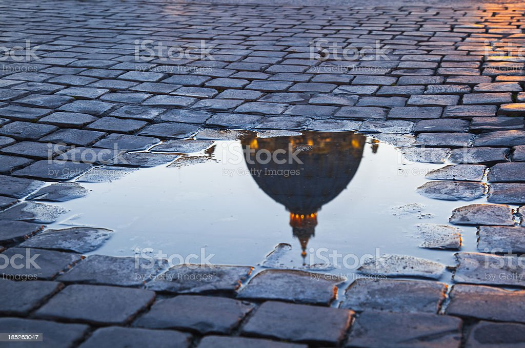 Puddle on Saint Peter's Square stock photo
