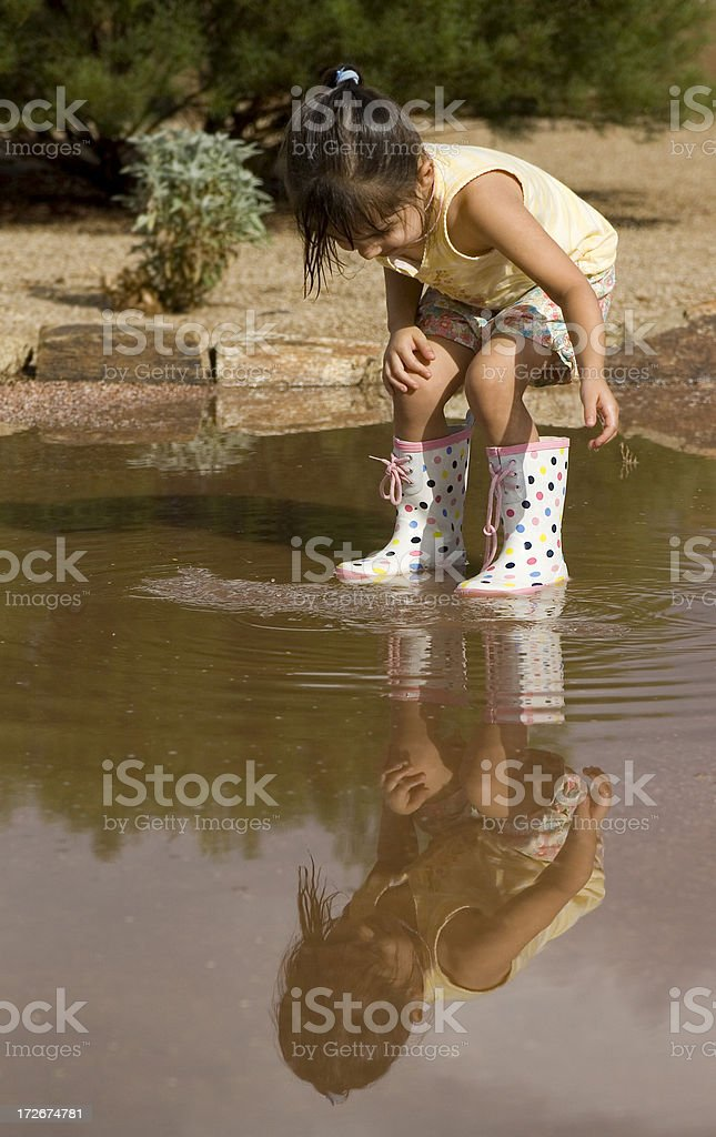 Puddle Play royalty-free stock photo
