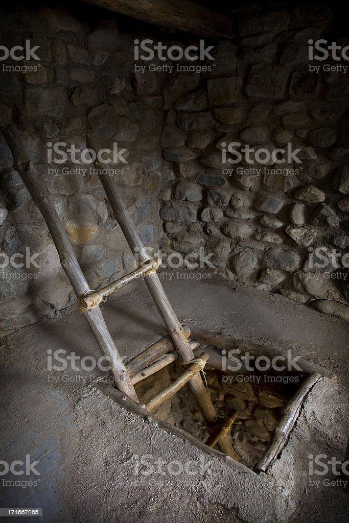 Pueblo Ladder Coming through Opening in Floor stock photo
