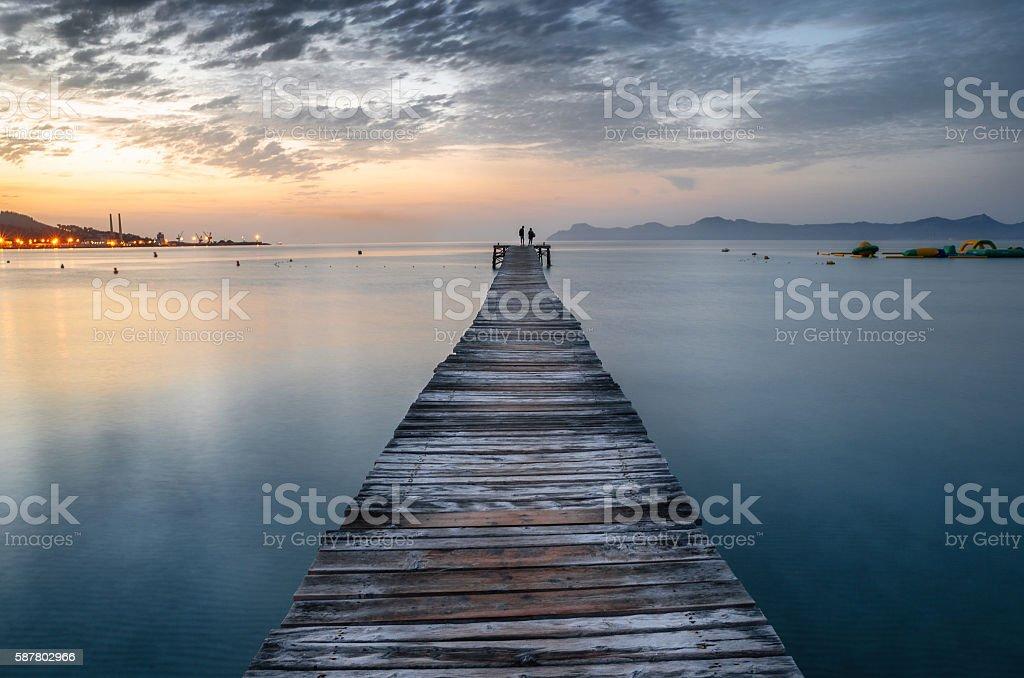 Puerto de Alcudia beach pier at sunrise in Mallorca, Spain stock photo