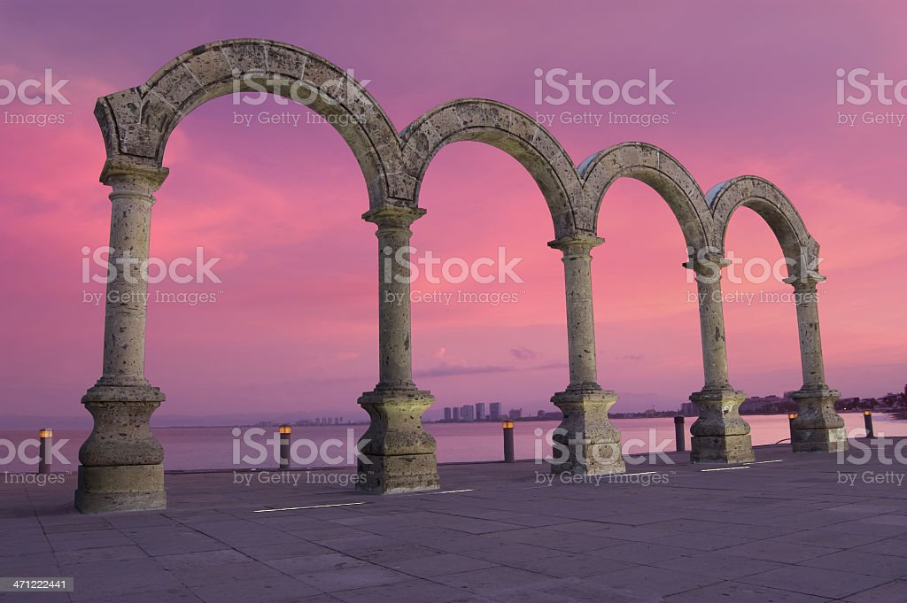 """Puerto Vallarta's Downtown """"Los Arcos"""" Arches and Pink Sky stock photo"""