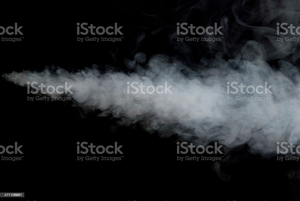 Puff of smoke against a black background stock photo