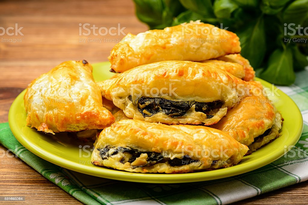 Puff pastries with spinach and cheese. stock photo
