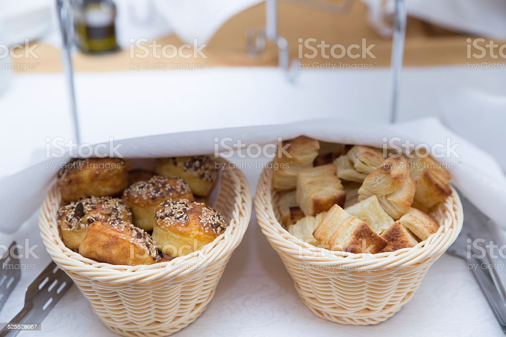 Puff Pastry and Corn Pone on table stock photo