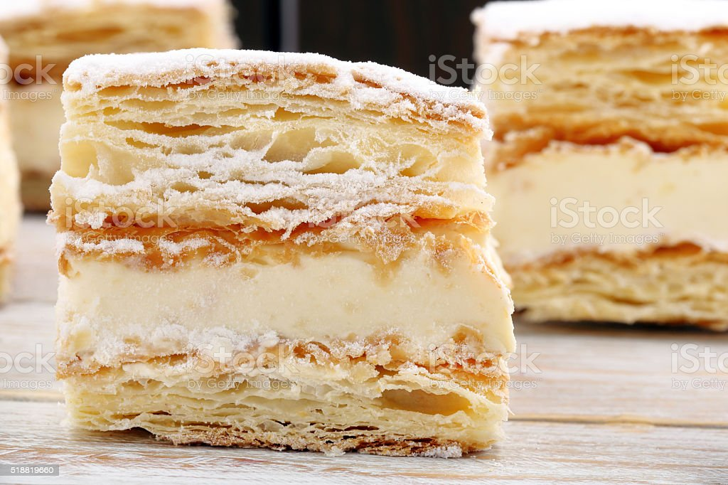 Puff pastry cake on wooden background stock photo
