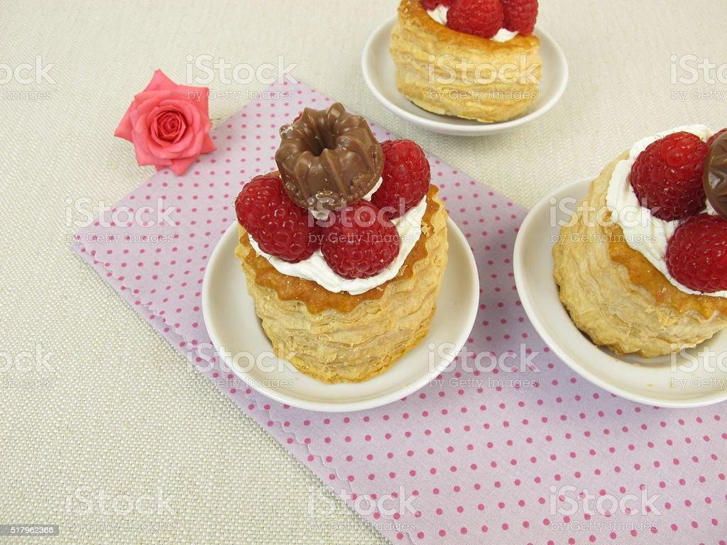 Puff pastry filled with raspberry, whipped cream and chocolate stock photo