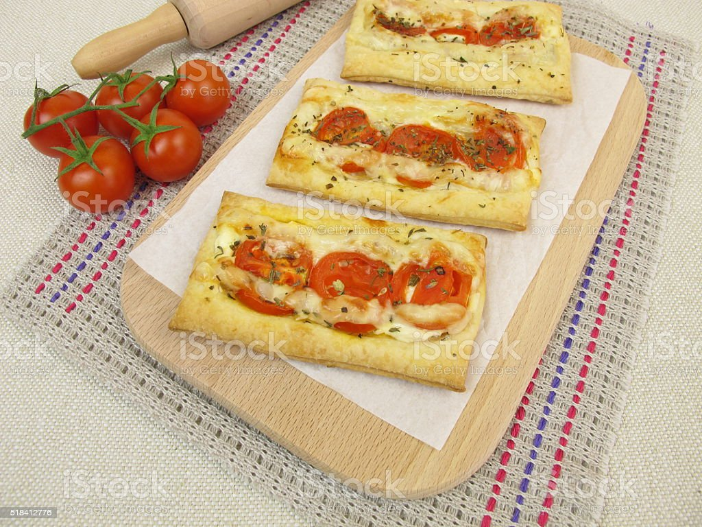 Puff pastry pizza with tomato and cheese stock photo