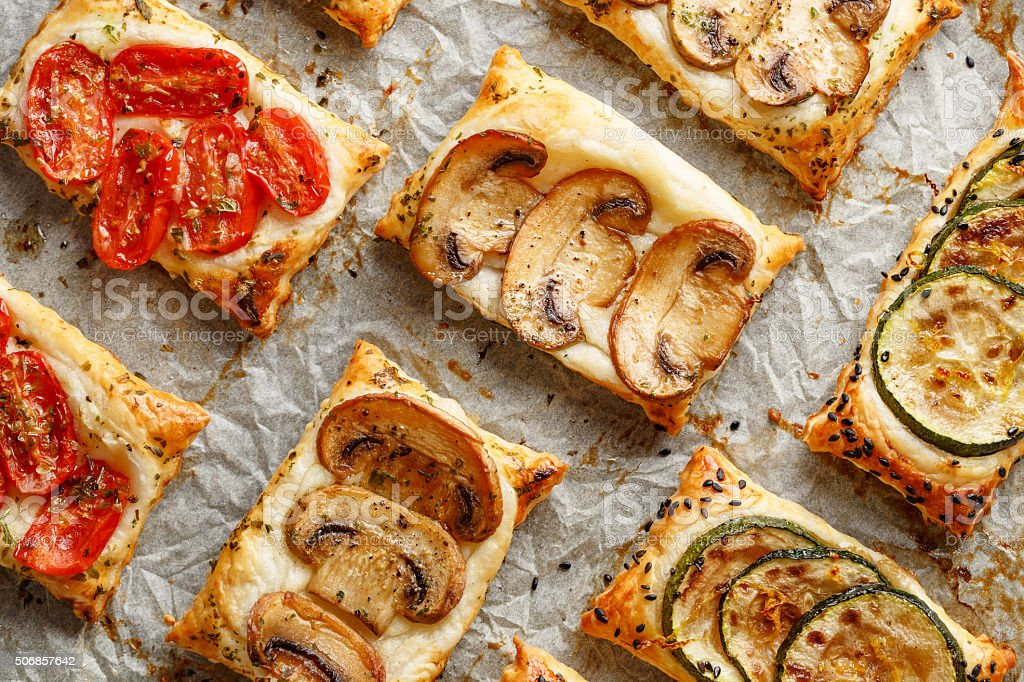 Puff pastry small tarts with vegetables stock photo