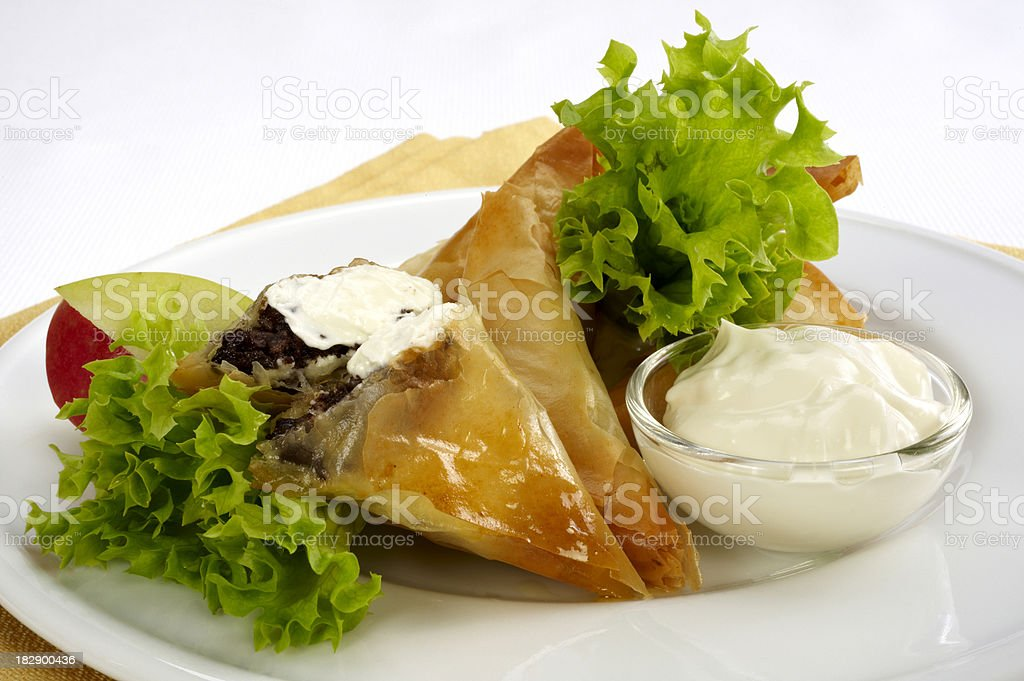 Puff pastry with cheese, sausage and apple stock photo