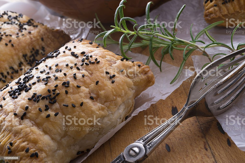 puff pastry with spinach filling and black cumin stock photo