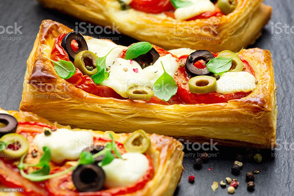 Puff pastry with tomatoes and mozzarella stock photo