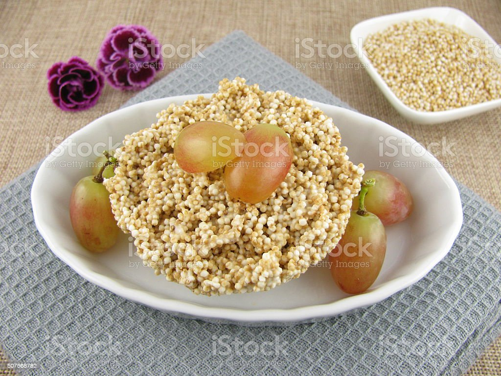 Puffed amaranth with white chocolate and grapes stock photo