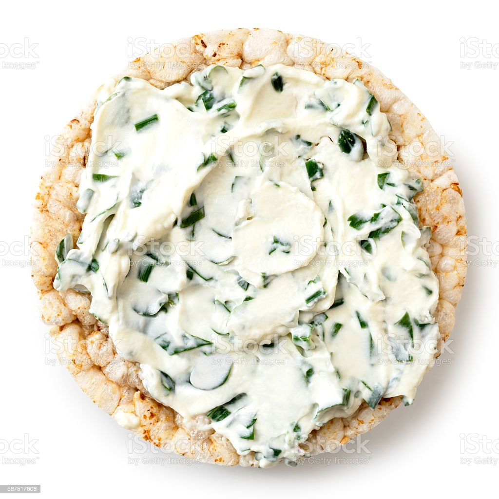 Puffed rice cake with chive and herb spread. stock photo