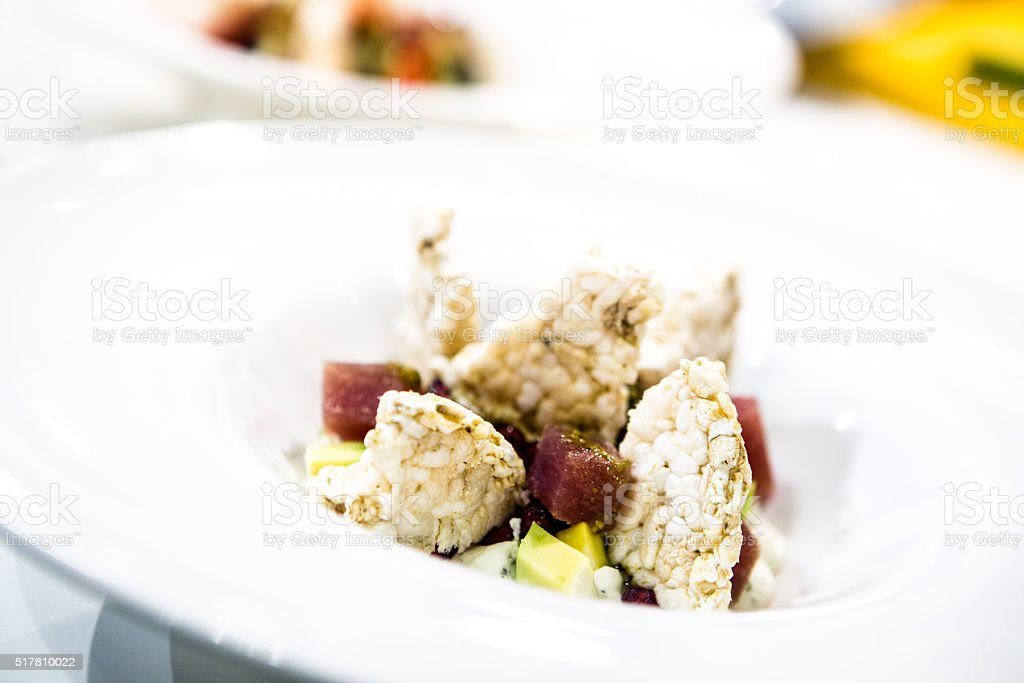 puffed rice salad, strawberries, pomegranate, vegetables stock photo