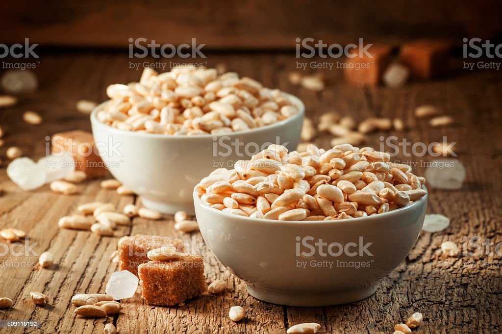 puffed sweet rice in caramel in white porcelain bowls stock photo