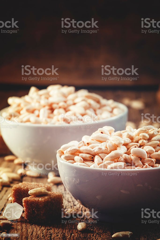Puffed sweet rice on old wooden table stock photo