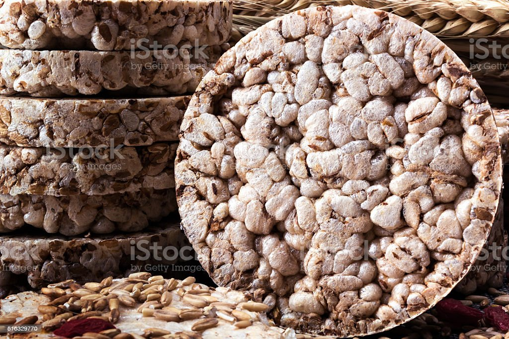 Puffed wheat cake, grains of wheat  and goji berries stock photo