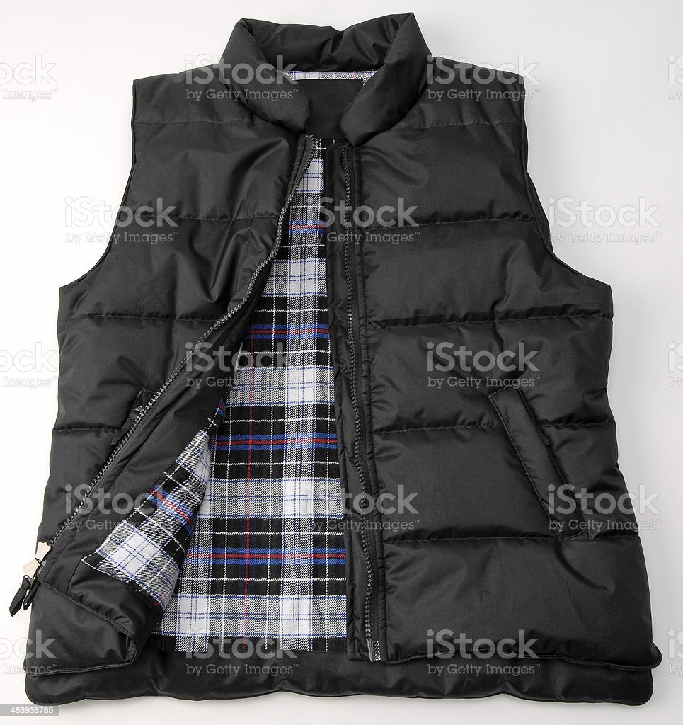 Puffy Black Hunting Vest With Fleece checkered inside stock photo