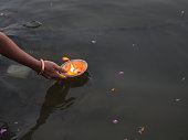 Puja With Candle Offering On Ganges River, Varanasi