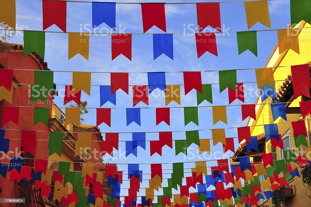 Pula,Sardinia, Italy: street covered in colorful  banners stock photo