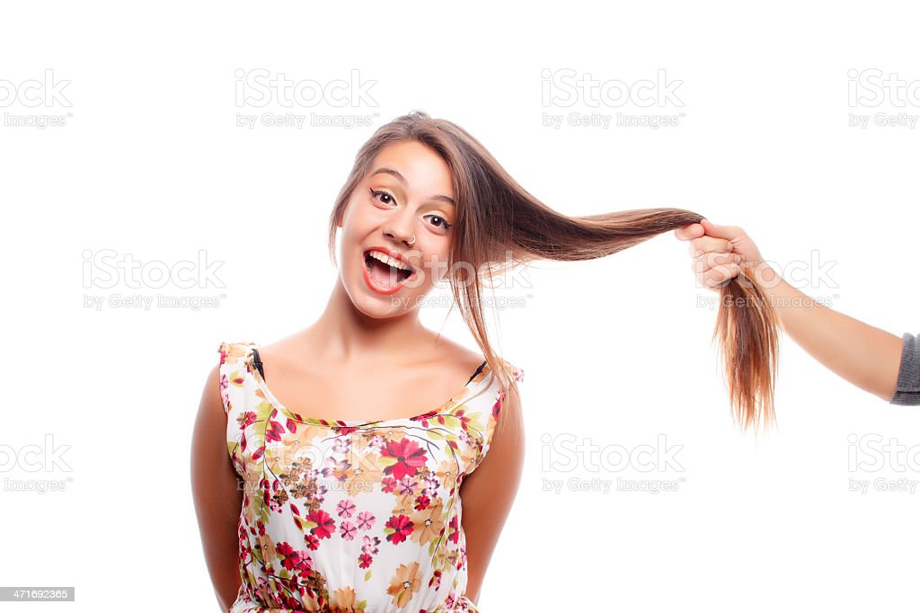 Pull hair royalty-free stock photo