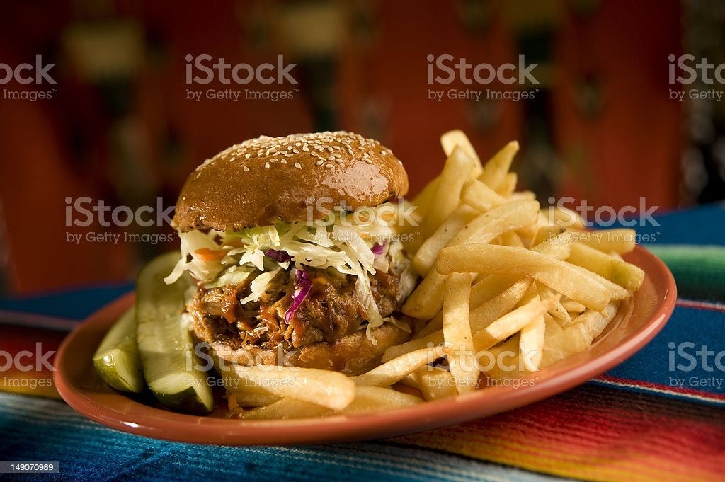 BBQ pull pork sandwich with fries and pickles stock photo