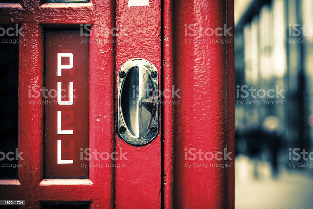 Pull to Enter, English Telephone Booth in London royalty-free stock photo