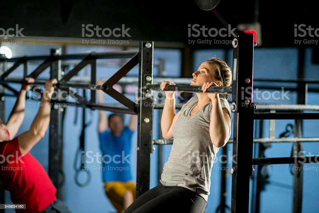Pull Ups at the Gym stock photo