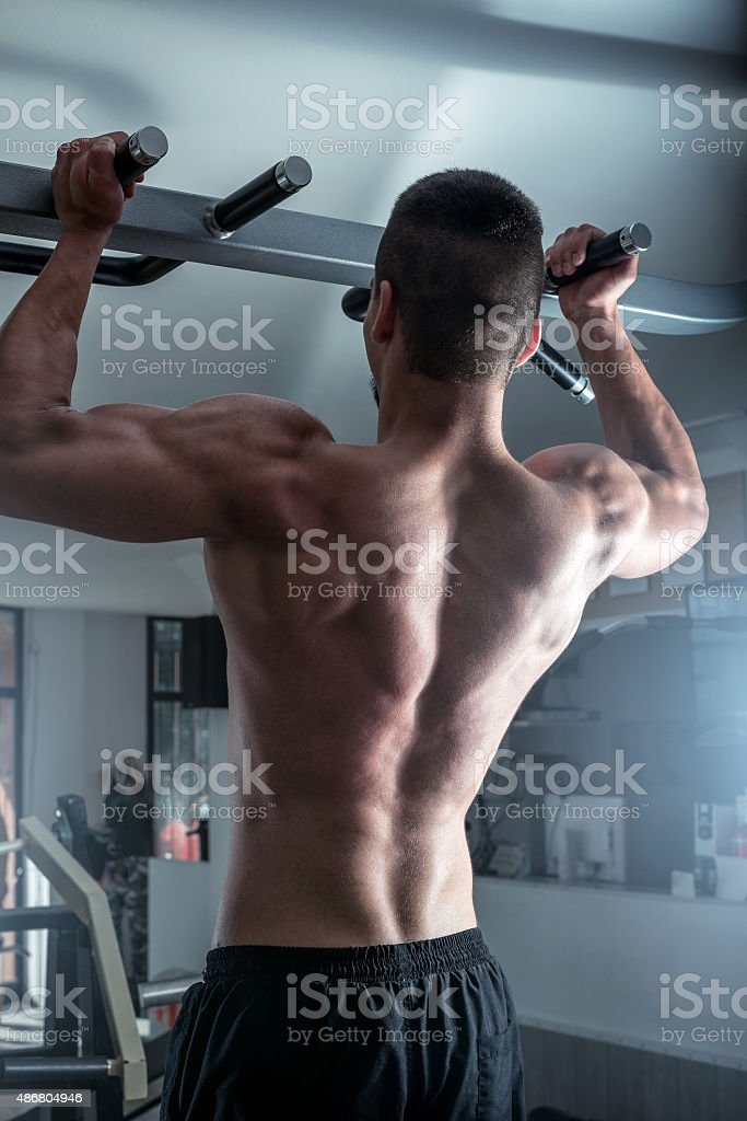 Pull ups in gym stock photo